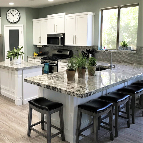 Changing this two level peninsula to a single level countertop was a game changer. Two tier reduces the space efficiency on both sides - narrow eating area and narrow food prep area. A flat countertop offers much more useable space.