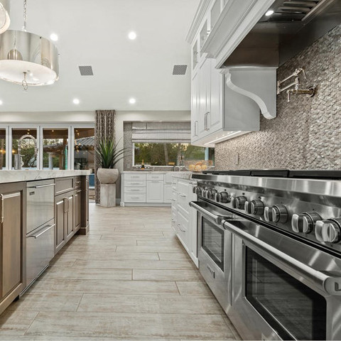 I could talk about when designing a neutral color scheme, let texture play a starring role like this backsplash tile. I could talk about pot-fillers, drawer-style dishwashers and coordinating lighting. Not going there. I just can't get past this range. Is it not the most beautiful thing you've ever seen?