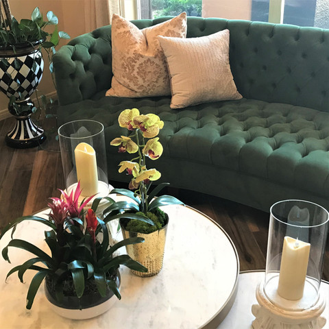 """An emerald green velvet tufted sofa is just so luxurious. The round coffee tables complement the sofa's curve. My mom used to call sofas """"davenports"""" and ottomans """"hassocks."""" Does anyone else remember that?"""