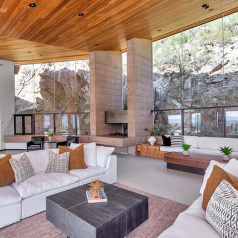 With an amazing cliff view like this and the expansive warm wood ceiling, it's important to keep the furniture and décor understated. Mother Nature is truly the best artist!