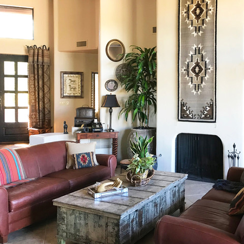 This Native American blanket was the perfect size for our fireplace and an opportunity to draw your eyes up. It pairs well with the theme of this house, chock-full of Southwestern treasures.
