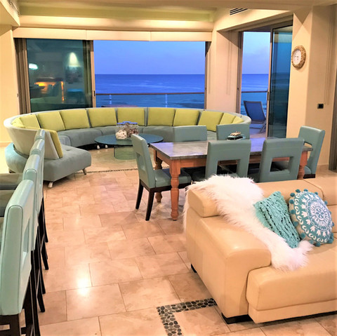 A soft and cheerful color palette keeps this beach condo looking serene. Not shown: Ceilings are painted in a soft blue color inspired by the sea and sky.