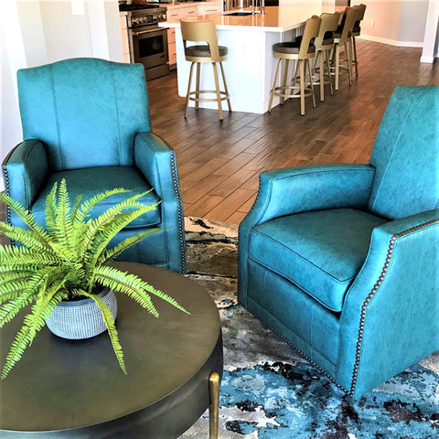 """Deep color creates drama. The vibrant rug anchors accent """"glider"""" chairs that are equally comfy and handsome."""