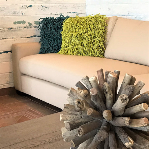 Leather, driftwood, color, texture... all at home in this casual beach house.