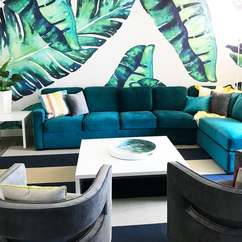 A stunning tropical mural makes a great first impression at this vacation rental.  A plethora of palm trees in the backyard inspired our breezy vibe indoors.