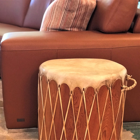 I like to use objects in unexpected ways. This drum doubles as an end table. Someone was actually taking it out of their vehicle at a consignment shop and we bought it in the parking lot. It found a perfect new home in this family room.
