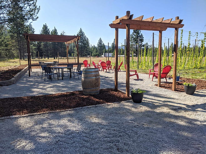 Outdoor patio next to a hop yard with ar