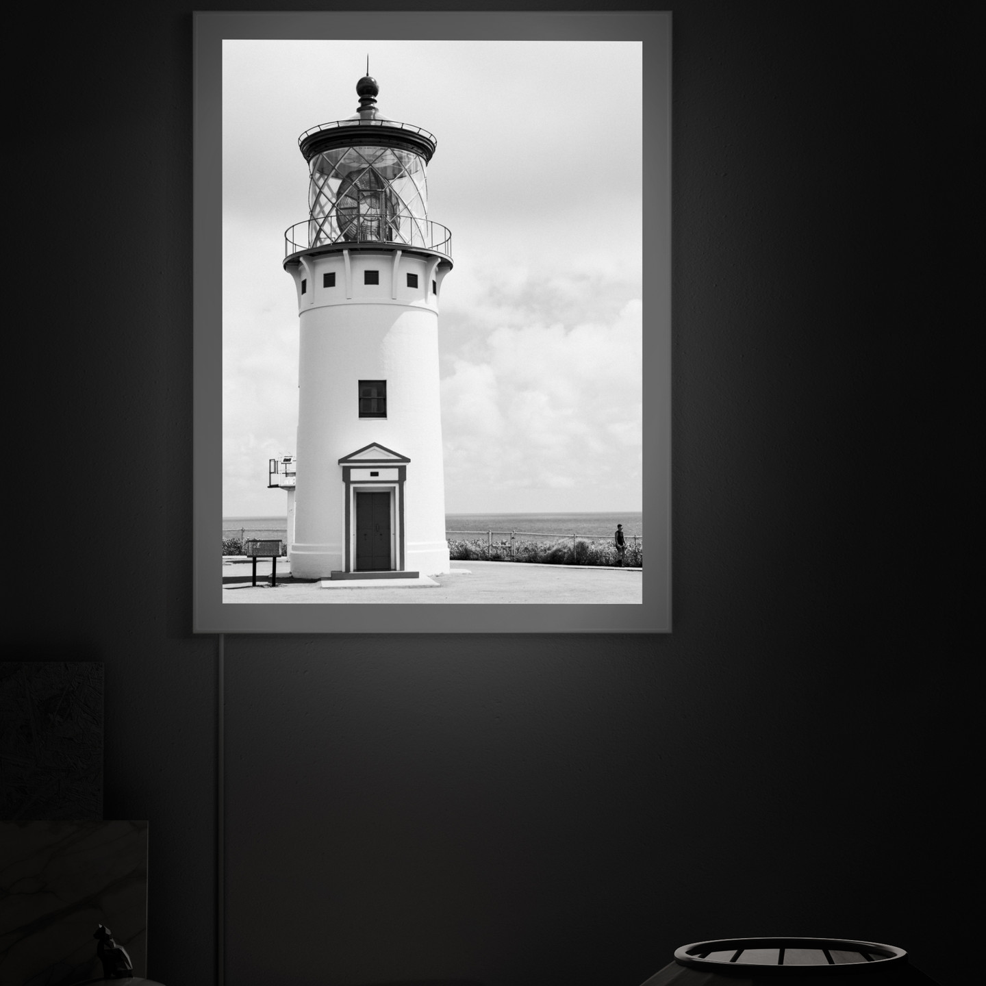 Guide Home by Andrew McFarlane showing a black and white lighthouse photo in backlit frame