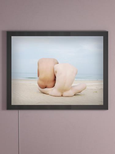 Omer Gaash art in a backlit frame