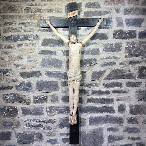 A magnificent French Canadian pine crucifix in original paint, Quebec c1850