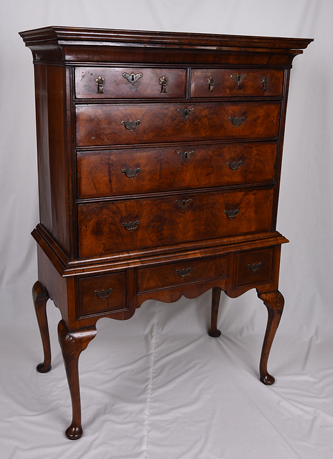 A Queen Anne figured walnut chest on stand, c1705