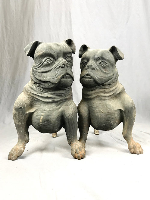 A pair of late 19th/early 20th C cast iron bulldog andirons, original surface