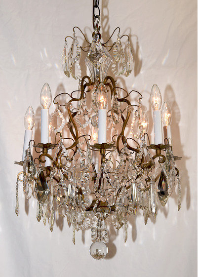 A twentieth Century Louis XIV style brass and crystal eight branch chandelier