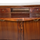 Thumbnail: A George III mahogany serpentine library cabinet with secretary drawer, c1790