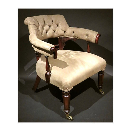A mid 19th C English Upholstered Library Chair, circa 1840