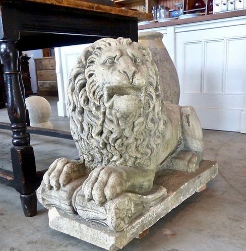 A pair of magnificent 19th C sculpted limestone seated lions