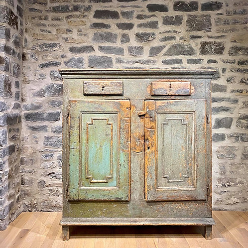 An exceptional French Canadian rustic painted low buffet, Quebec c1800