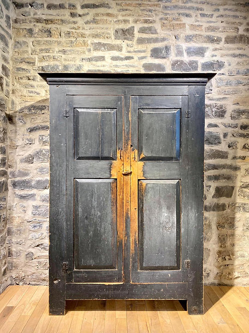 A striking mid 19th C French Canadian pine wardrobe in original paint, Quebec