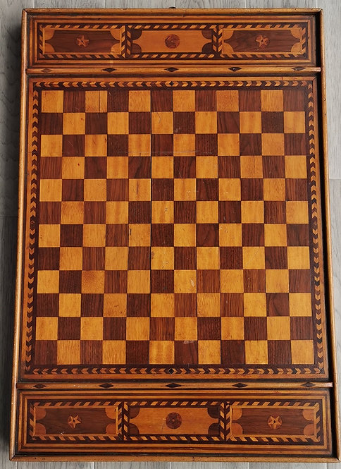 A large late 19th C Canadian folk art marquetry games board, Quebec