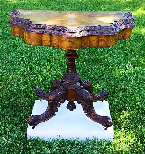 A mid 19th C Irish burl walnut card table, relief carving, leather surface