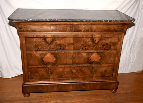 A Louis-Philippe figured walnut commode, c1810