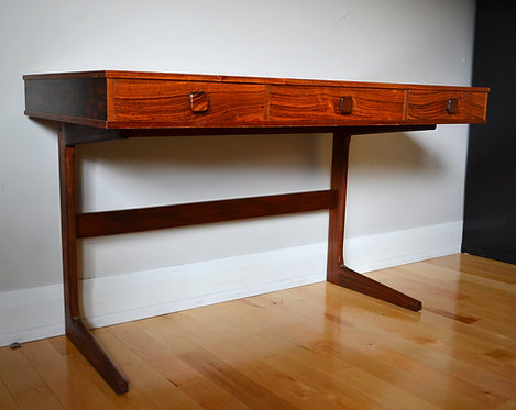 A mid-century Danish rosewood cantilevered desk, George Petersens