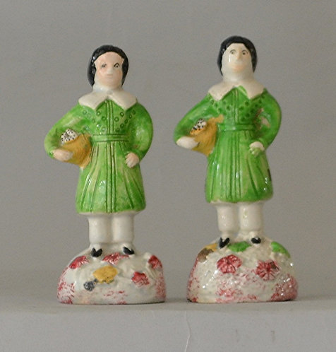 A charming pair of early 19th C Pearlware figures of young boys, English, c1820