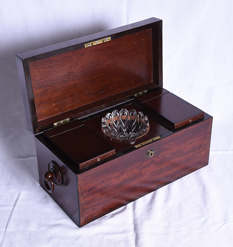 A Regency mahogany two division tea caddy with mixing bowl, c1810