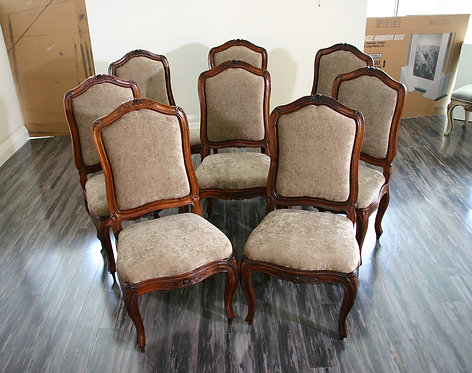 A set of eight Louis XV period walnut dining chairs, c1760