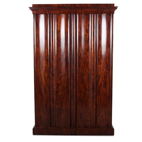 A 19thc plum pudding mahogany wardrobe / armoire fitted with ten drawers, c1850