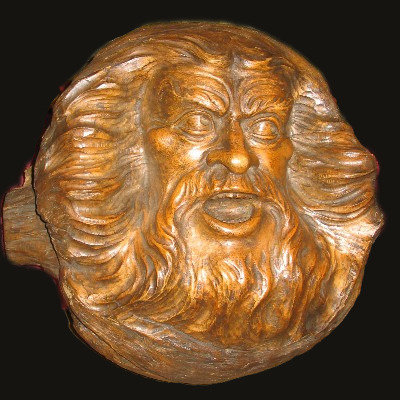 A 19thC Canadian wood carving of the Head of Zeus, Quebec