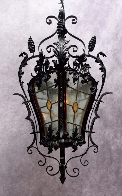A French 19th C scroll work wrought iron and leaded light lantern, circa 1870