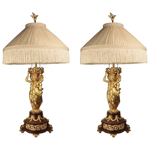 A pair of large belle Époque bronze doré three graces figural candelabras