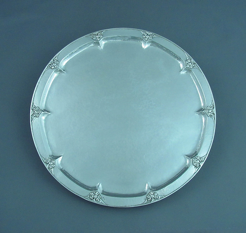 An English sterling silver salver by Omar Ramsden, hallmarked London 1928