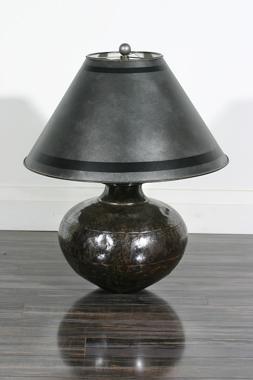 A 20th C polished and hand riveted steel lamp, likely Turkish