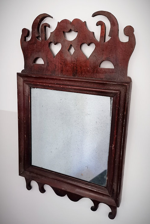 An early 19th C French Canadian 'last look' mirror in the Queen Anne style