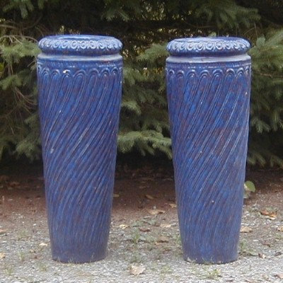 A pair of tall American earthenware vases