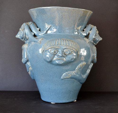 A monumental vase by Mary Anne Tattuinee, Rankin inlet, circa 1990