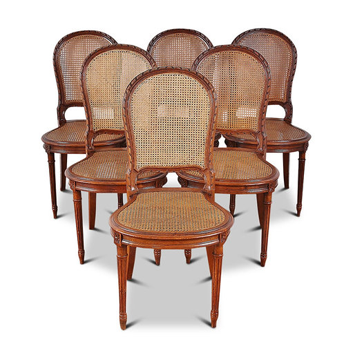 A set of eight late 19thc Louis XVI-style cane back oak dining chairs, c1890