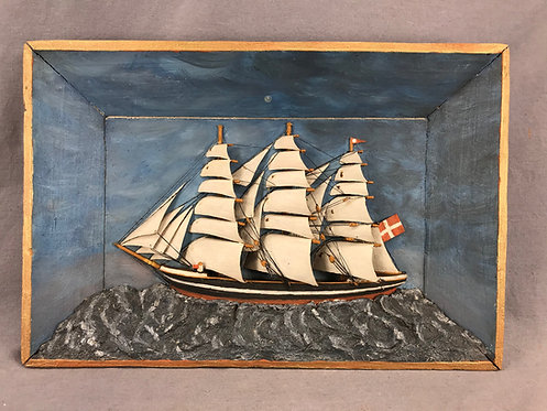 An early 20th C miniature ship diorama with 29 hand carved sails & plaster waves