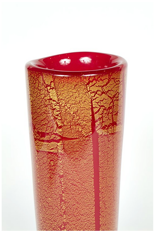 A vibrant red Murano glass vase, inset with gold leaf inclusions