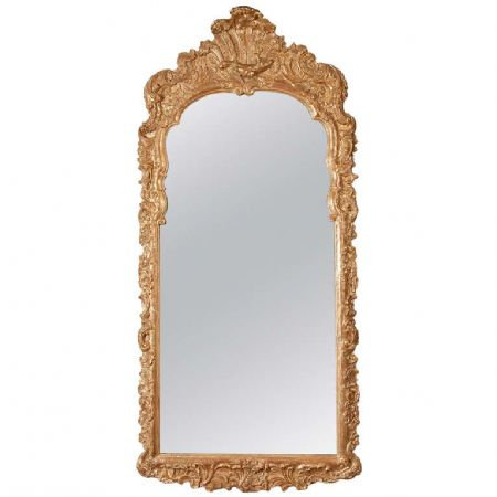 An early 18th C Continental giltwood pier mirror, c1720