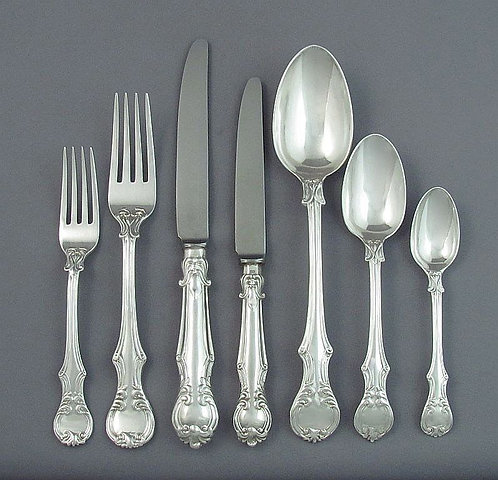 An exceptionally heavy Victorian sterling silver flatware service for 12
