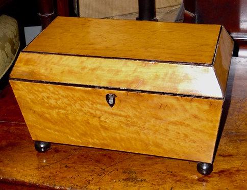 A Regency period satinwood tea caddy with ebony stringing & ball feet, c1810