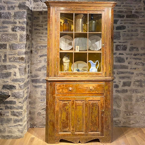 A majestic 19th C French Canadian pine corner cupboard, Quebec c1820-40