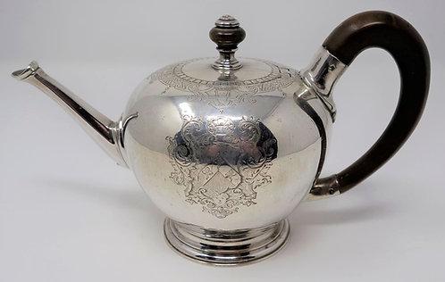 A silver George I bullet teapot of wonderful quality, John Eckfourd Junior
