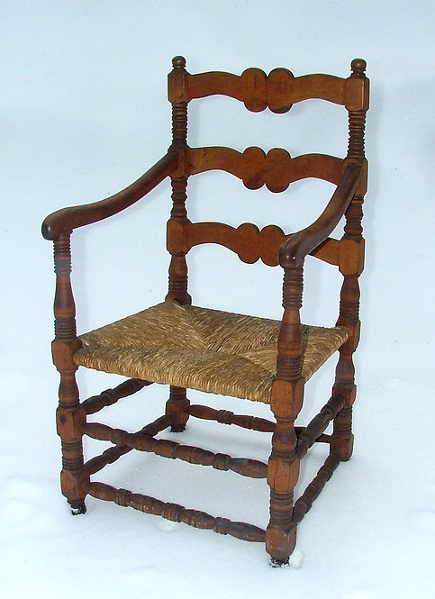 A late 18th C French Canadian maple fauteuil, Capucine style, Quebec