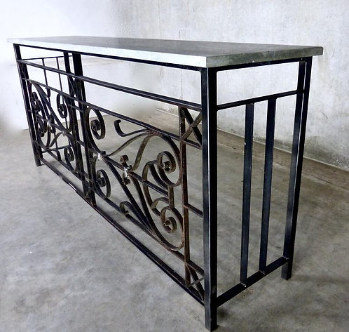 A pair of marble topped French wrought iron railing console tables circa 1900