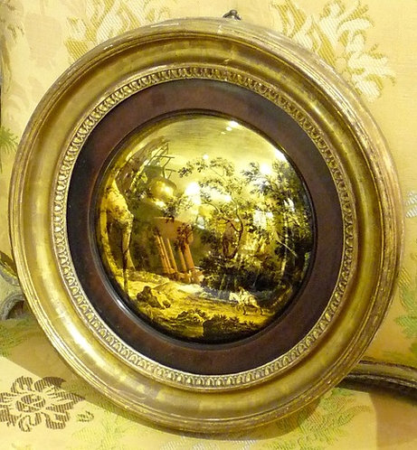 A Regency period diminutive convex wall mirror, with eglomise design, c1820