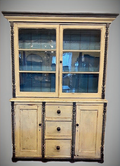 A 19th C painted pine two-piece glazed wall cabinet circa 1870